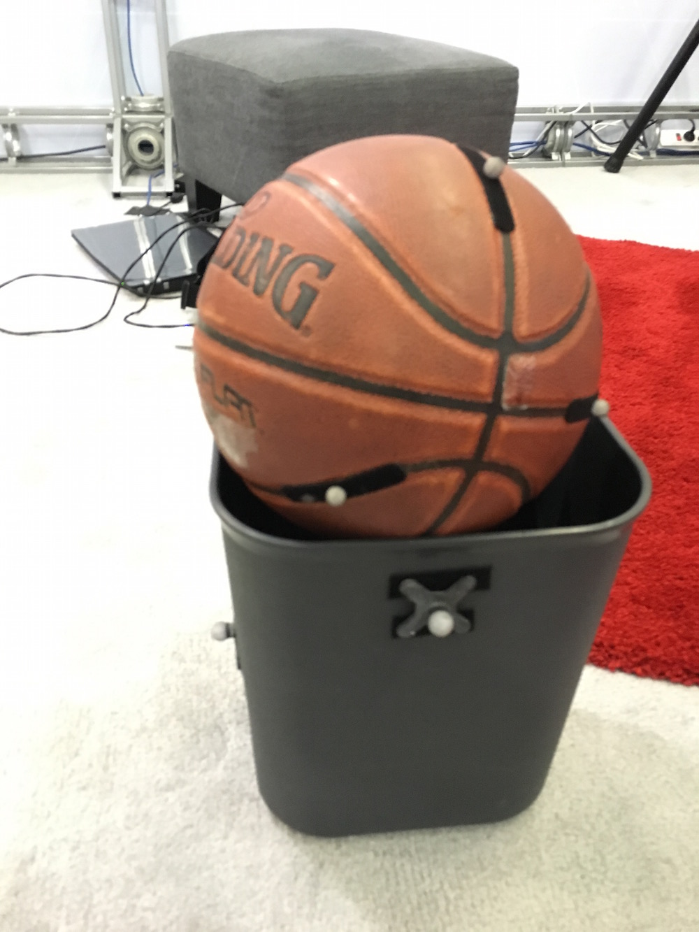 A basketball and trash can that are being brought into VR by Project Alice.