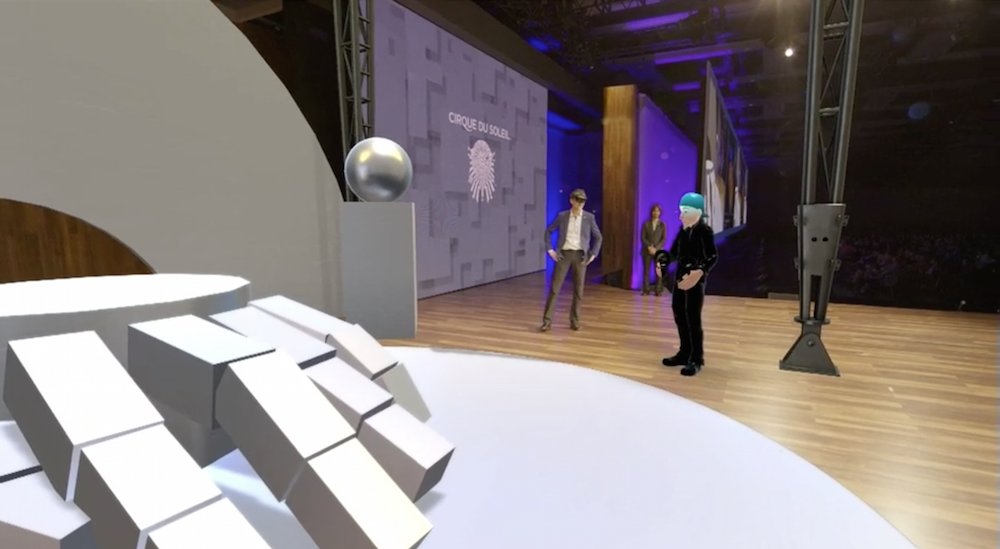 The VR avatar materialized on stage,